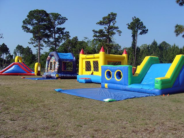 backyard water slide event party rental in ormond beach yellow red