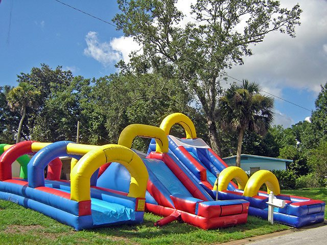 backyard water slide event rental in bunnell red blue yellow