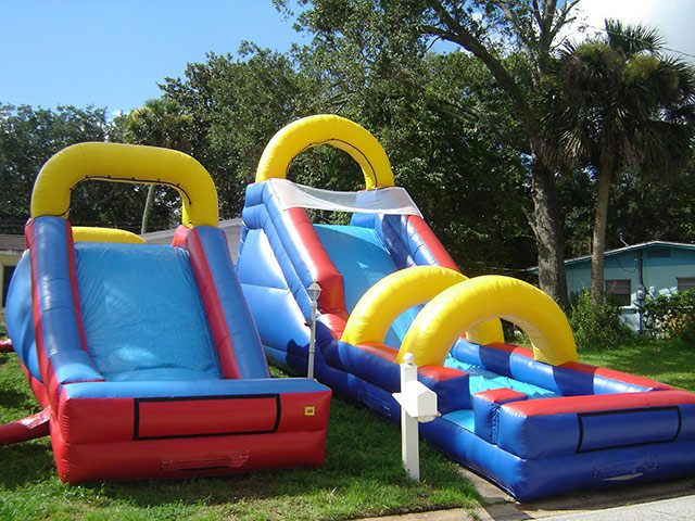 backyard water slide blue red event rental in palm coast